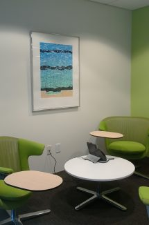 installed artwork in a bright green office